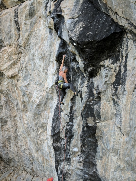 Lenore moving past the third bolt en route to the fourth bolt crux.