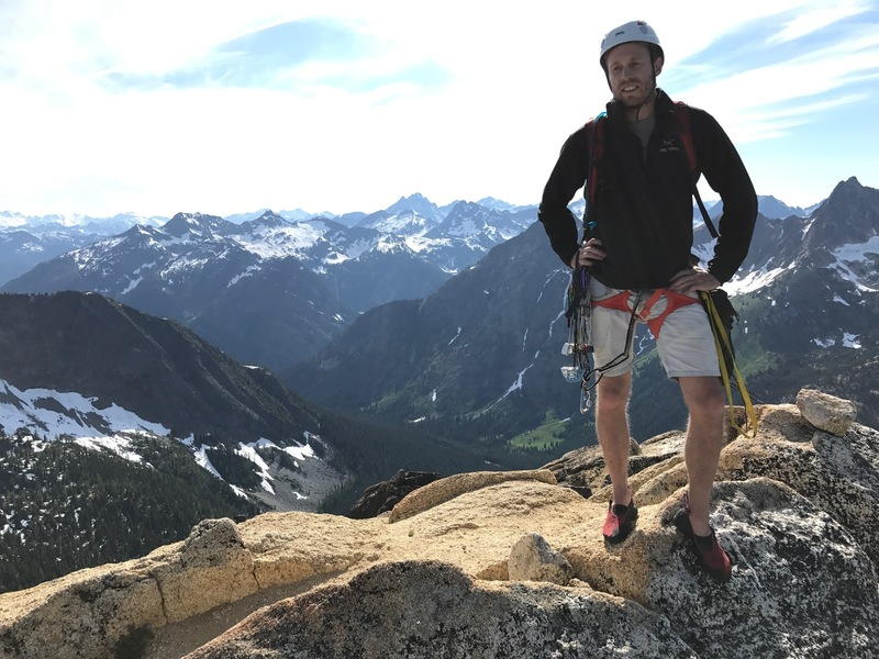 A shot of Zach on the summit facing north.