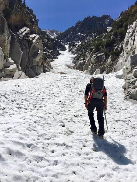 Chris leading up on 4,000+ feet of snow & névé couloir.