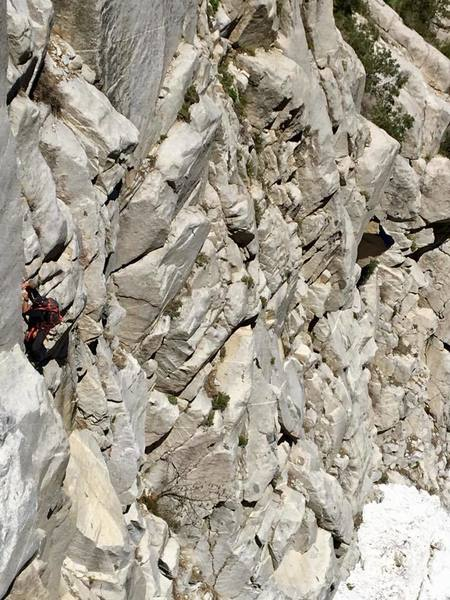 Another shot of Chris free soloing the rock route I took up past the choke stone. 50-60 feet (5.4-5.5)