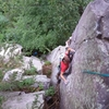 Fiddling in the #0 C3, the crux piece for the final headwall.