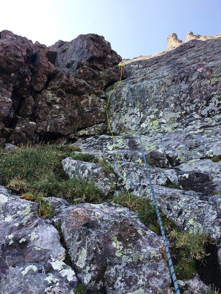 After climbing this easy boulder problem on the 2nd pitch, you'll have around 60 feet of 3rd Class to the second pitch anchor. 2c.