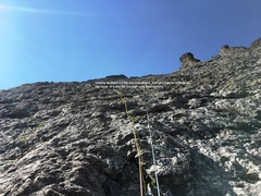 Climb up and slightly left into a wide gully system.  Find the fourth pitch anchor of no return on the left side of the system.