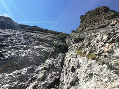 This picture looks up the last 300 to 400 feet of the right-leaning dihedral/crack system. Stay on the left of the system to avoid potentially loose rock. Use the system when needed for protection, but sling the pro with longer runners. The climbing here ranges from 5.6 max rolling over to easier grades.