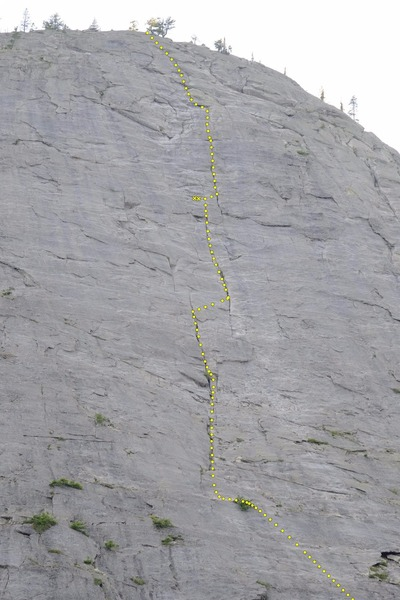 This shot shows all but the first 1.5 pitches of the Regular Route. Location of the two bolt belay might not be spot on, but they're up there somewhere.