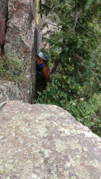 Melissa struggles through the tree to the pitch 2 belay.