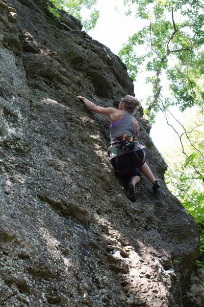 Erica climbing Slingshot.