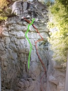The Green line is reach the beach The red line is fortress. There seems to be a lot of confusion on this but I hope this clears the mud.  the crack in the small roof then climb past a bolt to another crack left then another bolt to the top.