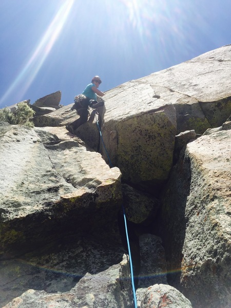 Shot from the belay ledge on top of pitch 1, heading up and to the right into the double cracks. We chose the left crack as recommended in the route description and were not disappointed. There is a jammed cam (basically welded) into the rock around 5 feet above the belay ledge, for reference.