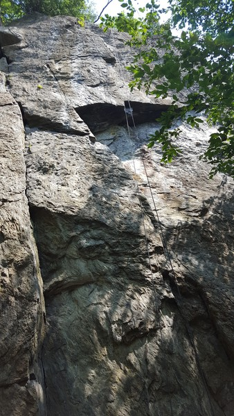 The rope is directly over the route, where the very start of the climb is cut off.