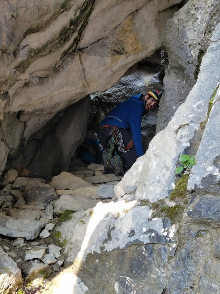 Entrance to the tunnel/ cave, at top of pitch 10, that leads to the top of the waterfall.
