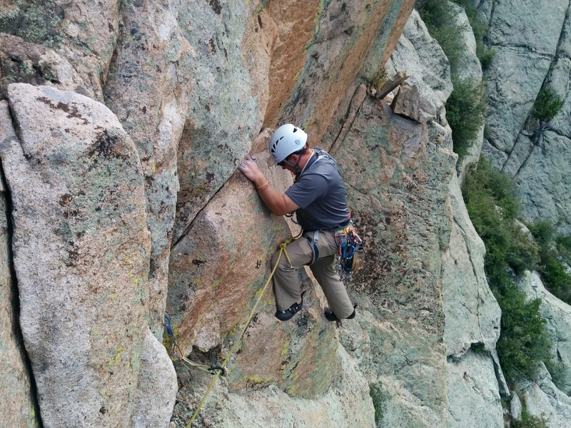 LJ on the traverse just before the P3 anchor.<br> <br> Be mindful of the detached block seen in the foreground!