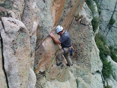 LJ on the traverse just before the P3 anchor. <br /> <br />Be mindful of the detached block seen in the foreground!