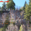 The Front Bluffs loom directly above the Roadside bluffs and are accessed by a trail through the boulderfield to the west or by bushwacking from Dance Park. This cliff is steeper with both sport and traditional routes.