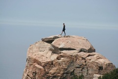 Rock Climbing Photo: Dylan Odenthal on top of Sphinx Rock.