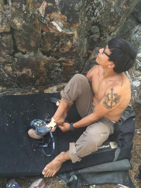 At the base of the warmup boulder