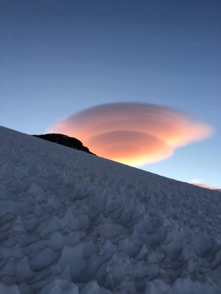 A Lenticular cloud seen after topping out the Kautz Ice Chutes