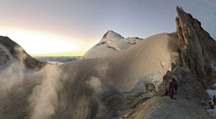Climbers watching sunrise at Sherman Crater after climbing the Easton Glacier.