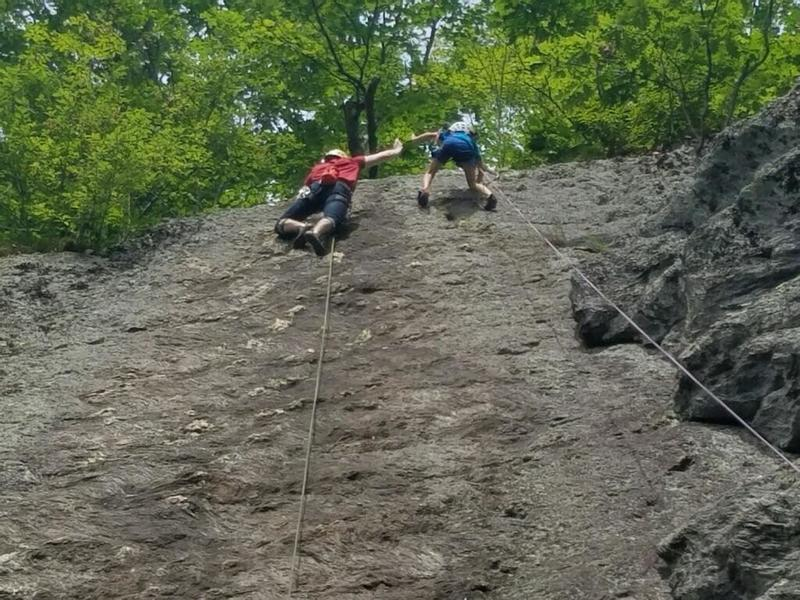 Cleaning Boltline while high-fiving a prety rad kid who was climbing the unbolted face next to me.