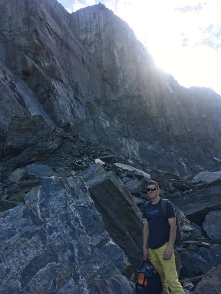 Pat walking back on the new approach Trail after a day of climbing at the Sunnyside and Republic. Nick and Dalton are climbing a new trade route in the background on the Worthington main buttress