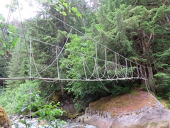 Rock Climbing Photo: Rope bridge crossing the river between the road an...