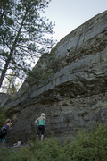 Cody climbing and Stephanie on belay. <br />Cody has never climbed before and makes it to the top!
