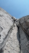 Rock Climbing Photo: Moving left to undercling flake, pitch 4.