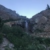 When you reach the first waterfall you'll cross the creek and ascend the rock band via climbers left.