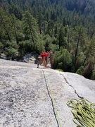 Rock Climbing Photo: Climber nearing top of Pitch 2.