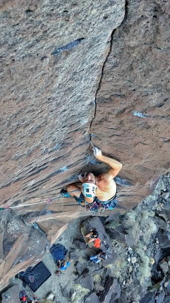 Fiddling gear into the thin start of the upper crack.<br> Photo by Will