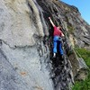 Moving out of the crux on Broken Head.