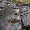 I think the guide book called Double Chin a 5.4 with two stars. Note, this climb has two ceilings. I'd say 5.6, 5 stars!