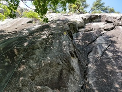 Rope hanging down Vertical Limit, with the right-facing corner of Vertically Challenged visible.