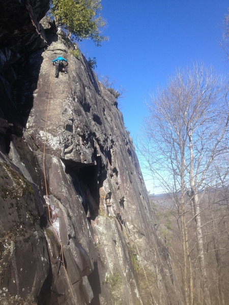 Jenna Damon heading up a very fun and moderate slab route with awesome views.