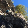 Jenna Damon rappelling the moderate slab climb, which starts with a few tricky moves.