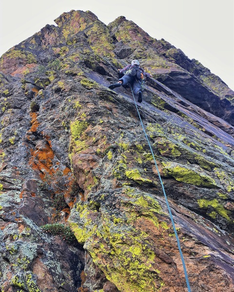 Rock Climbing Photo: Chris clipping the bolt on P1.