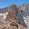 West along Pinnacle Ridge to its high point ... in front of higher ridge to L + needles directly behind + Mt Whitney summit to R