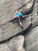 Charlotte (9) touring 'the' Tennessee Flake.  Can see the first hold on Solar Flare above her left hand.