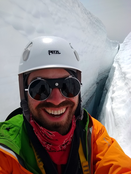 Crevasse rescue training. I was in the crevasse as a victim. I practiced using a waist and Texas kick prusik to climb the rope. I also practiced self-arresting my partners fall, setting up snow anchors and building a 3 to 1 and 6 to 1 pulley system to haul the victim out.