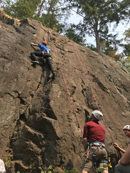 Belaying a top rope partner in Washington.