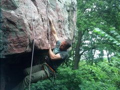 Pulling the roof crux.