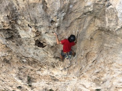 """Jorge Lassus in the second of three cruxes on """"Arete Murcielago"""" (Bat Arete) 12c (35m) on The Ciales River Wall."""