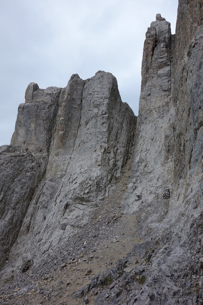 After 5 single-rope rappels, scramble over to the notch in the photo. Make 5 more single-rope rappels (or double rope if you dare) down the other side.