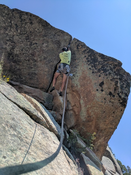 Tony B. warming up for the day on the FA (presumed) of 'Give Me a Break' (5.10d?) on the Lower/Left Breaks.