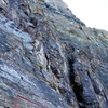 """The route description says to climb though a """"cave-like chimney"""" in the area where the rock quality deteriorates and the route enters a band of """"chocolate-colored rock."""" This may or may not be the correct chimney, but either way it was pretty fun to climb and worked quite well."""