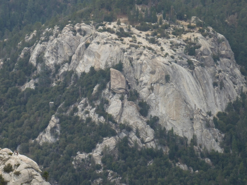 Zoomed in shot of two climbers on Tahquitz's summit in the lower left hand corner and Suicide Rock.