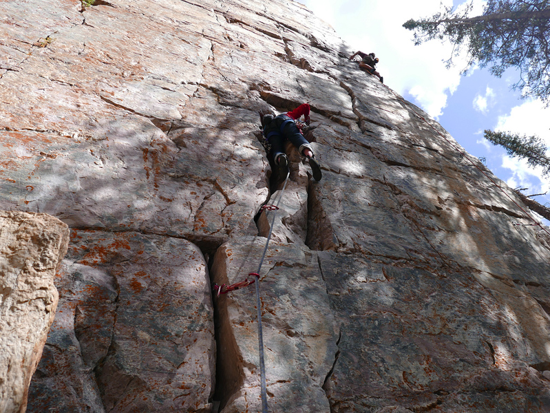 Climber on Extra Dry at Air Voyage Wall.