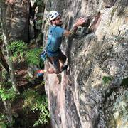FA of Three Raccoons in a Patagonia Fleece. Just past the crux and finishing up the business before the long 5.9 ending.