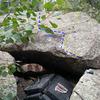 Boulder 30 ft below trail