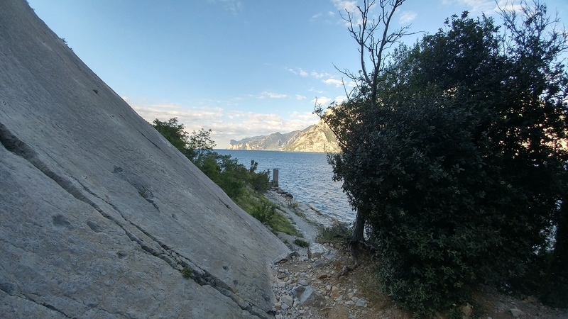 Standing at the base, looking climber's right, toward the lake.